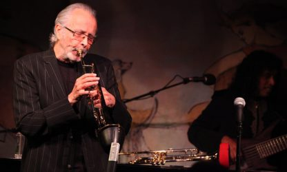 Herb Alpert with his bucket mute by Soulo Mute